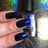 Unforeseen- a deep French navy with a fine aurora shimmer that shifts a little to purple.