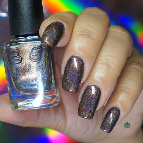 Under his brow - deep brown linear holo