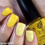 Belle of the Ball – a yellow to very light yellow thermal, gold and red holo microglitter throughout