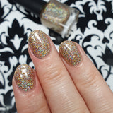 Hasta La Vista 2020 – a perfect New Year's Eve polish with super holographic micro glitters in silver, gold and copper. Can be used as a topper or is opaque in three coats