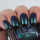 Draco – aurora shimmer polish that moves from a beautiful emerald green to purple with pink and blue flecks