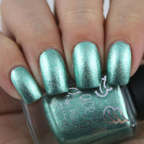 Imagine That A mint green metallic flake foil with teeny silver metallic flakes that makes this polish dance
