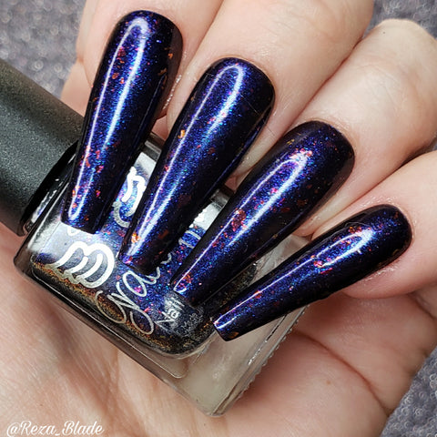 Capsicle – purple/blue aurora shimmer base with red and gold chameleon flakes