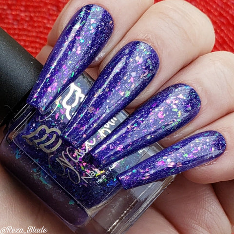 Eve Magic – an indigo jelly with crystal colour shifting flakes in pink/violet/green/gold and holo flakes