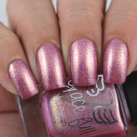 Spoonful of Sugar A pretty peachy pink linear holo with gold shimmer throughout