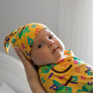 Bumblito - Stretch Swaddle - newborn swaddle - Chicka Chicka Boom Boom - yellow swaddle with alphabet letters