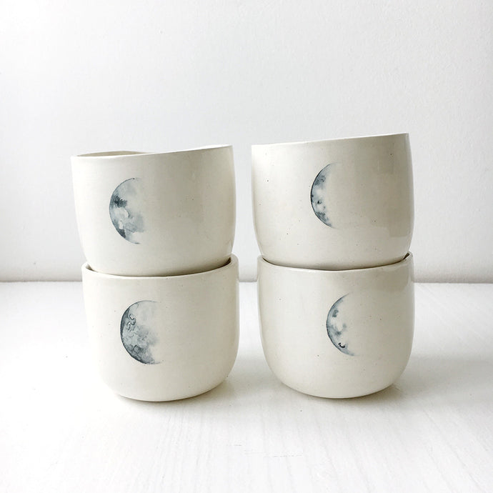 A set of four lunar mugs