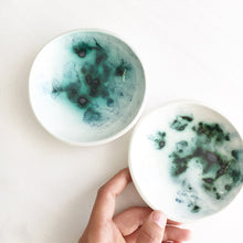 A set of four green galaxy trinket bowls