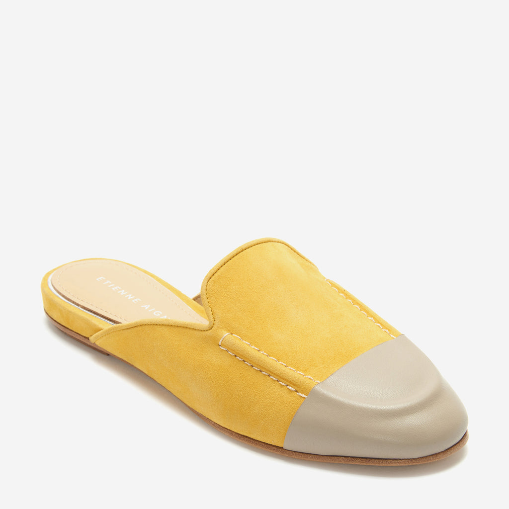 etienne aigner cora flat mule loafer in saffron yellow suede with beige leather wrapped toe cap