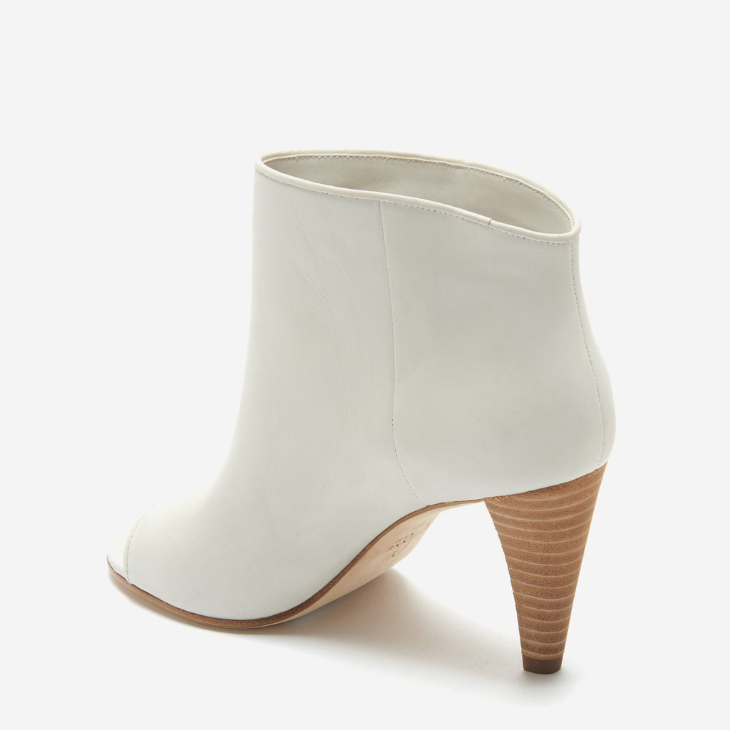 etienne aigner simone slip on peep toe bootie in white calf leather