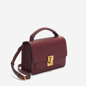 etienne aigner leah heritage clasp top handle crossbody in antic cordovan red