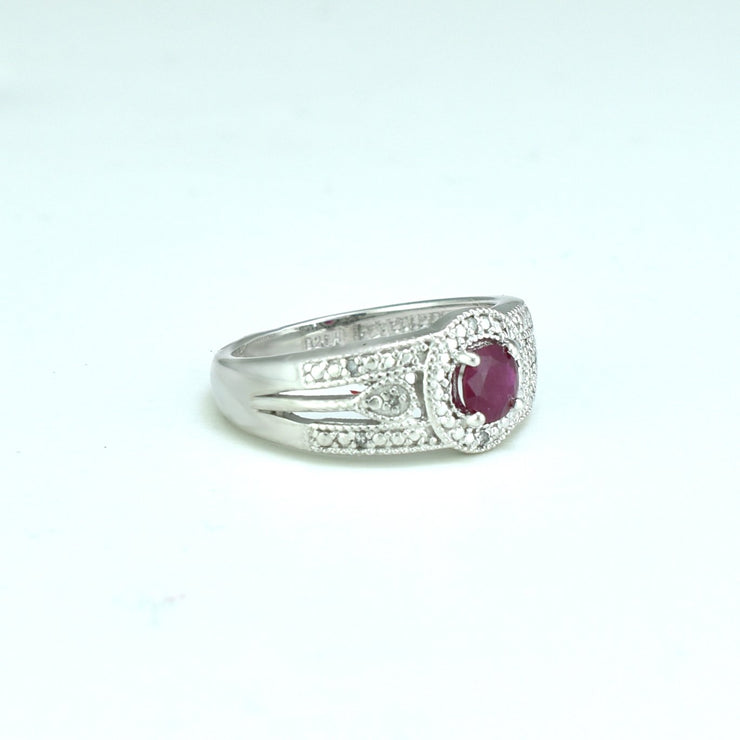 Genuine Ruby and Diamond Accent Fashion Ring in Silver