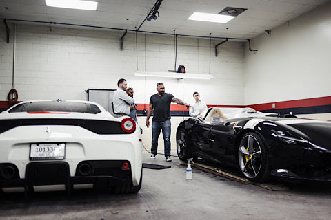 Andy looking at a ferrari