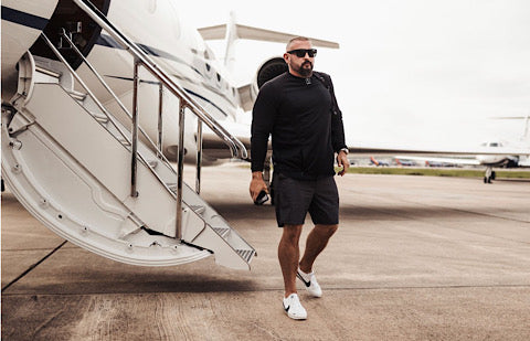 Andy walking off of a plane