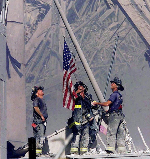 First responders putting up the flag