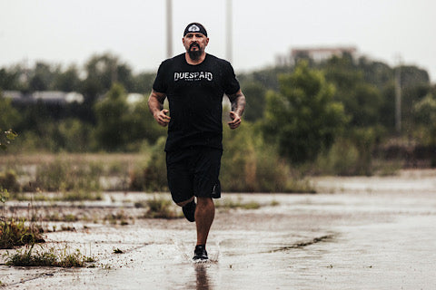 Andy running in the rain