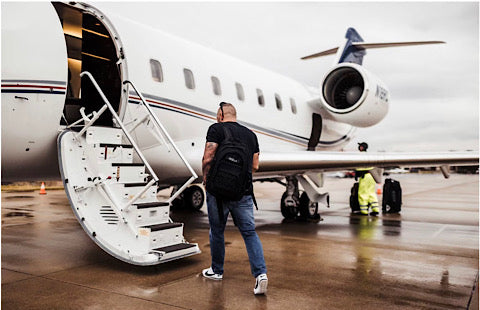 Andy walking onto a jet