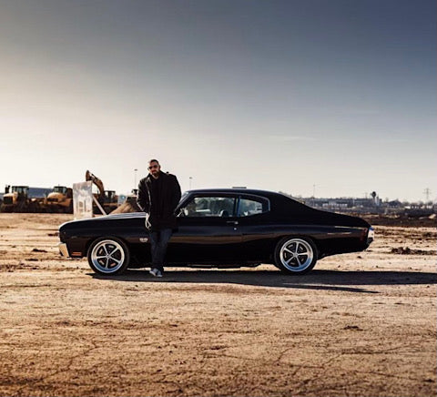 Andy standing next to his Chevelle