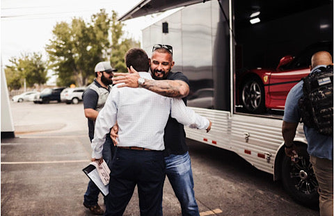 Andy hugging a friend