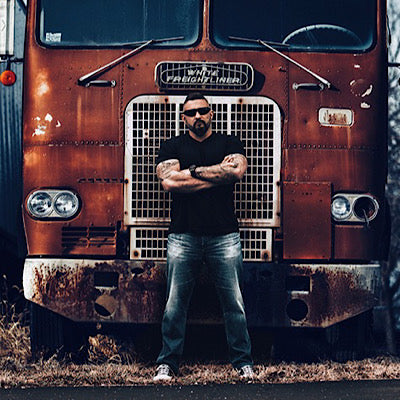 Andy standing in front of a truck