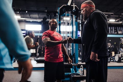 Andy talking to a man in the gym