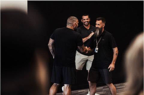 Andy shaking hands with an employee