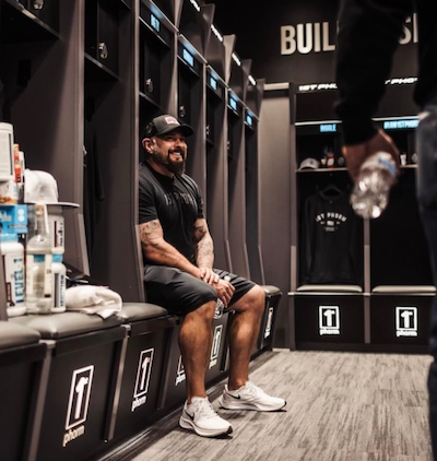 Andy sitting in a locker room