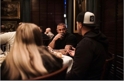 Andy sitting at a table talking to others