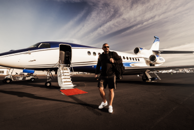 Andy walking off a jet