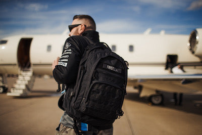 Andy walking to a plane