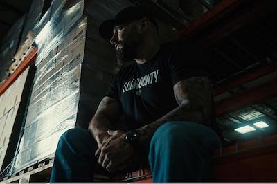 Andy sitting in the warehouse