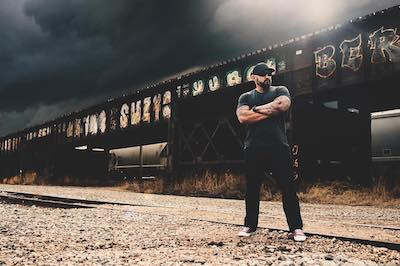 Andy standing next to train tracks