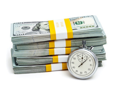 stack of money and a stopwatch