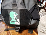 The Flitelite glow in te dark pvc patch secured to aviation bag
