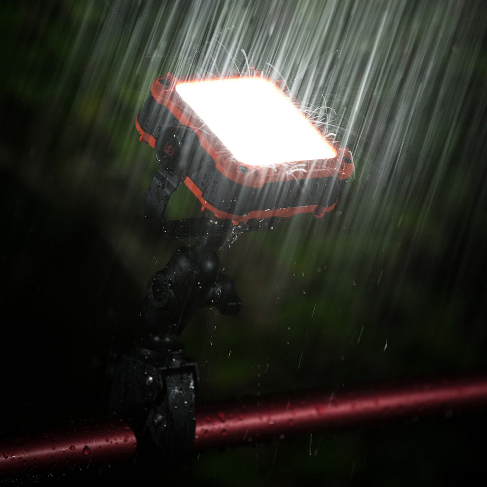 Gear Aid power station and light mounted in the rain