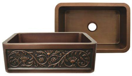 Copperhaus rectangular undermount sink with a Sun Flower design front apron