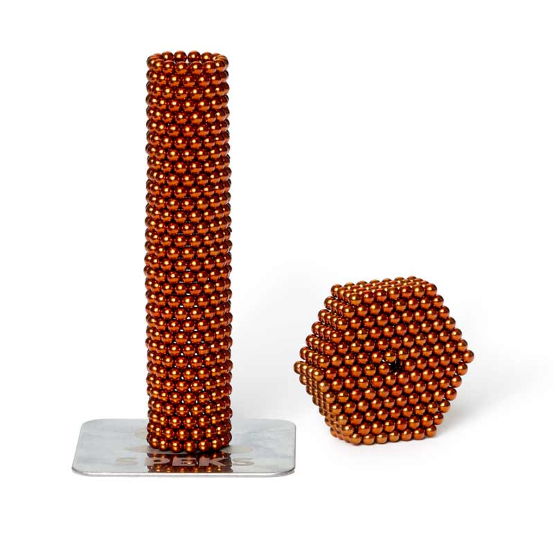 speks magnet ball desktoy in orange colorway