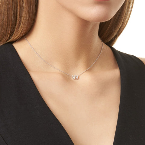 KIKICHIC This delicate CZ pavé letter W initial necklace is perfect for every day. Adorable initial necklace featuring in silver and 18k gold finish with CZ stone. Simple, delicate and elegance, perfect to match your outfit for everyday wear or for a special event. Dainty, simple, elegant and sweet design made to keep your loved one near your heart. The perfect gift to celebrate birthday, anniversary, valentine's, Christmas or more.
