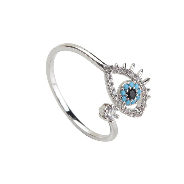 "KIKICHIC Evil Eye Adjustable Ring, Turquoise Stones Evil Eye Open Ring, CZ Pave Diamonds Evil Eye Pinky Ring Open Adjustable. Beautiful attention to detail makes this minimalist evil eye ring truly special. This protective evil eye ring will not only protect your spirit, but also your style! Wearing this evil eye ring is a ""Luck Charm"" believed to ""reflect evil"" and thereby protects a person who wears it against misfortune."