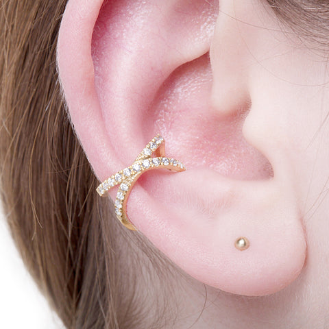 KIKICHIC Pave CZ Cross Ear Cuff. Hand-set Clear Cubic Zirconia stones. Adjustable Ear Cuff, No Piercing Necessary, just easily slip over the ear. This can be worn either on the left or right ear. Simple design but make a huge statement! Each of these ear cuffs are handcrafted of sterling silver, then plated with 14k rose gold and 14k white gold.