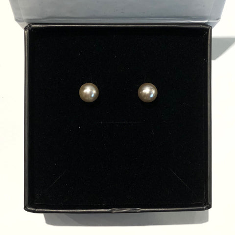 KIKICHIC Freshwater Pearl Round Stud Earrings Silver, Small Pearl Everyday Earrings, White Pearl Earrings, Pink Pearl Earrings, Gray Pearl Earrings. We're picky about our pearls. These gem-quality pearls are natural freshwater beauties, set in solid stainless steel that won't tarnish or flake. We may have expensive taste, but crazy mark-ups aren't really our thing.