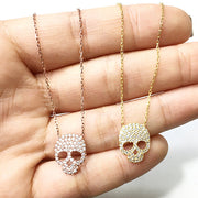 KIKICHIC Add a gorgeous and sophisticated glow to any outfit with our gorgeous sugar skull necklace. Perfect for dressing up or dressing down this gorgeous pendant is sure to be the center of attention on any ensemble. So that it's ready for gifting and ready to be worn. This item makes a gorgeous gift for Birthdays, anniversaries, weddings, and all other special occasions, and will be an item to cherish for years to come.