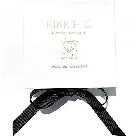 KIKICHIC. CZ Huggies Baguette Chain. A standout piece from our collection, a mini hoop embellished with cubic zirconia stones and 2 chain drops one delicately holds a single baguette stone. Modern and unique design made to keep your loved one near your heart. The perfect gift to celebrate birthday, anniversary, valentine's, Christmas or more.