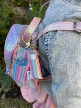 Pastel Gold Stripe LippyClip and SaniClip attached to sequined bacpack