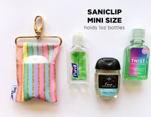 "The Mini SaniClip which holds 1 oz hand sanitizer bottles including BBW's PocketBac.  It measures 3"" x 5.5""."