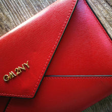 Red brushed leather envelope wallet close up