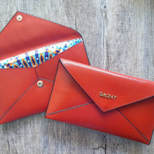 Red brushed leather envelope wallet with 'mosaic' print lining