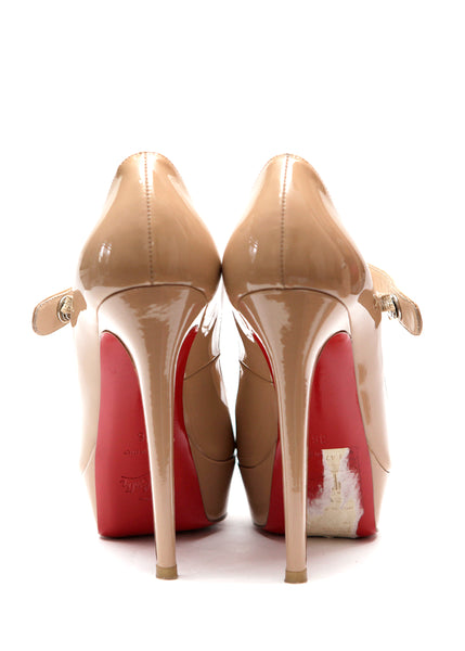 Back view of pre owned CHRISTIAN LOUBOUTIN Beige Patent Pumps