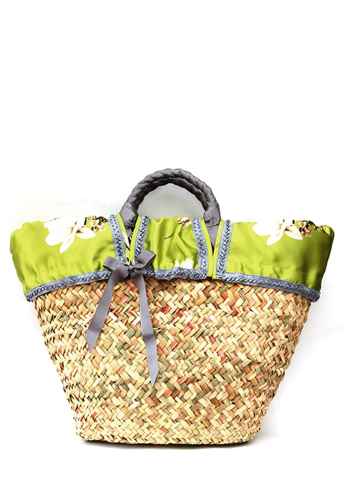 Front view ofStraw bag with combination insert of fabric and silver ribbon.
