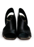 Front view of CELINE black leather strap sandals